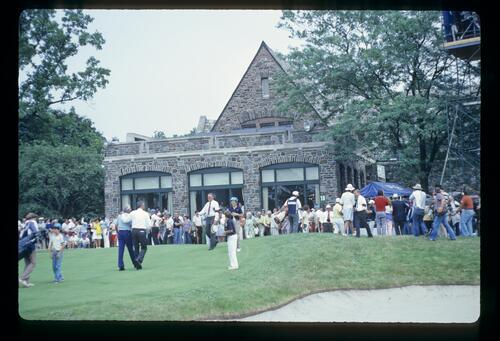 Golfers, caddies and officials leaving the 18th green at Oak Hill during the 1980 USPGA