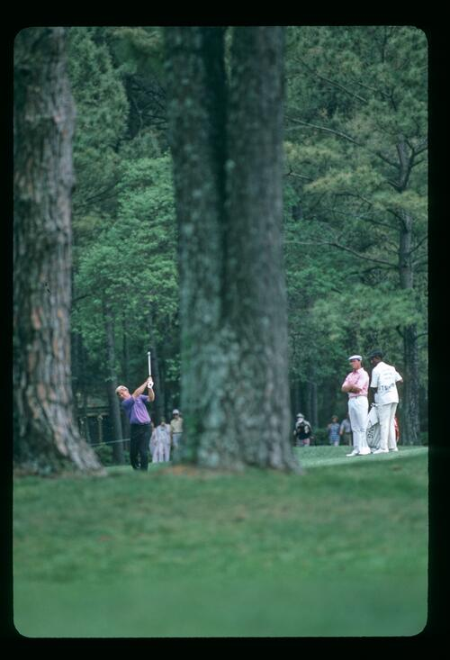 A scenic view through the trees of Hal Sutton playing his approach shot at the 1986 Heritage Classic at Harbour Town