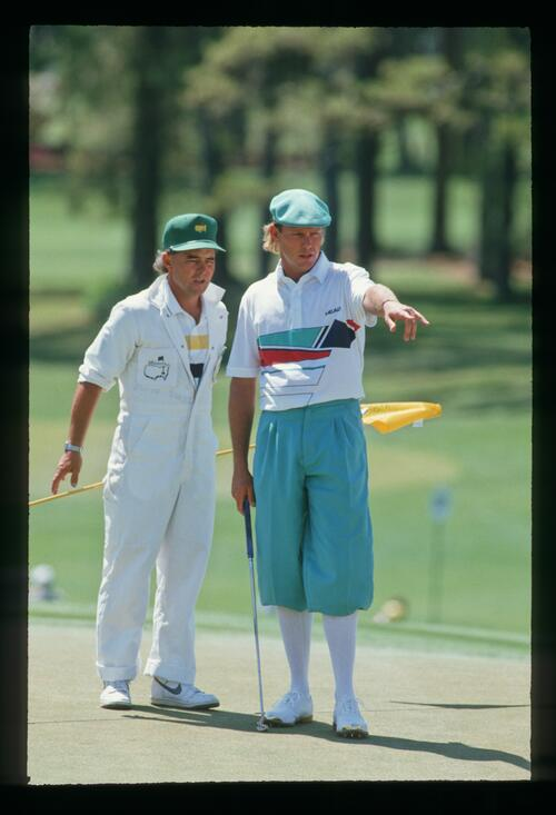 Golfer PAyne Stewart consults with his caddie about the line of his putt at the 1988 Masters Championship