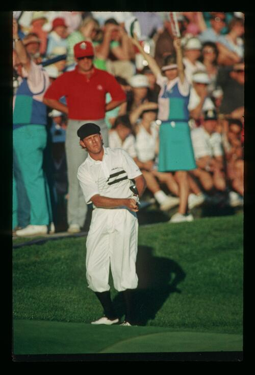 Golfer Payne Stewart pitches into the green from the fringe at the 1988 Players Championship at Sawgrass