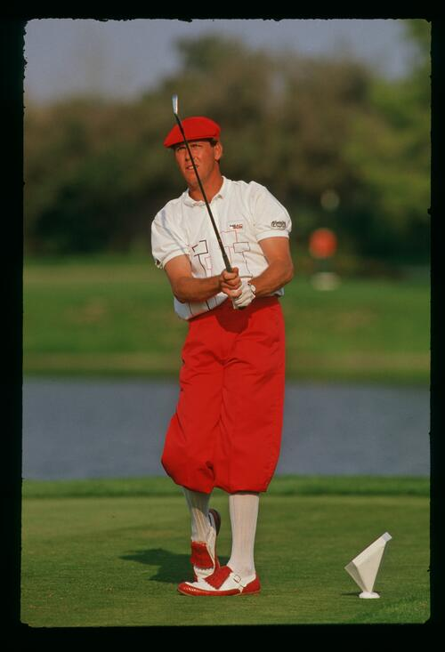 Payne Stewart dressed in bright red on the tee at the 1987 Bay Hill Classic