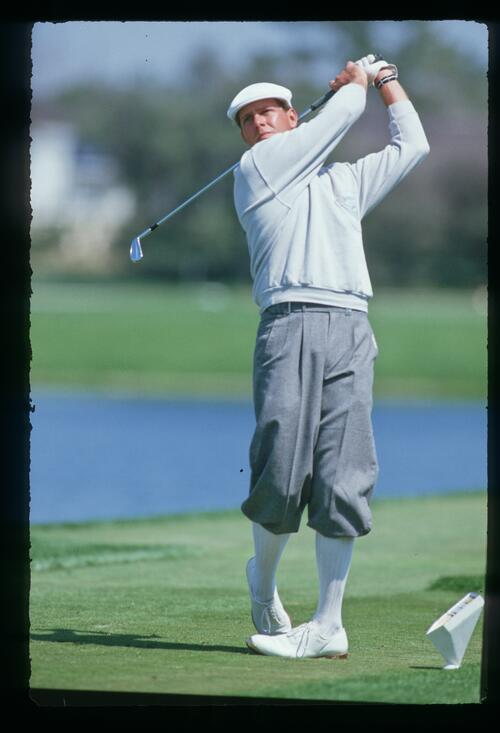 Golfer Payne Stewart tees off at the 1987 Bay Hill Classic