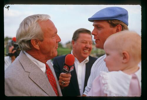 Winner of the 1987 Bay Hill Classic chats with Arnold Palmer during a television interview