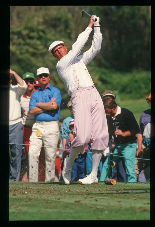 Golfer Payne Stewart dressed in pink tees off at the 1987 Masters Championship