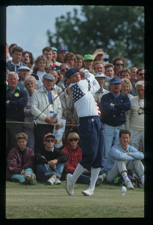 Golfer Payne Stewart dressed in American colours tees off on the 5th hole on Day 4 of the Open Championship at St Andrews