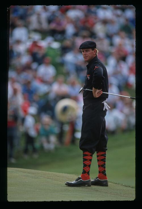 Payne Stewart wearing the colours of the NFL Cincinnati Bengals waits by the green at the 1989 Memorial Tournament at Muifield Village