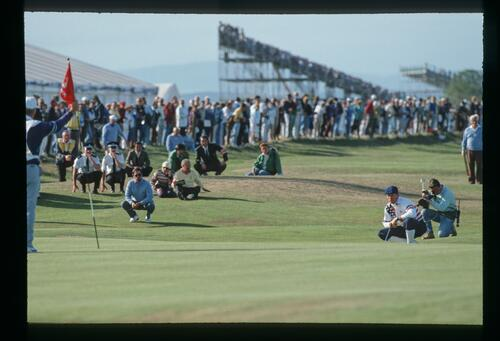 American golfer Payne Stewart surveys his long putt on the 16th hole of the Old Course at St Andrews during the 1990 Open Championship