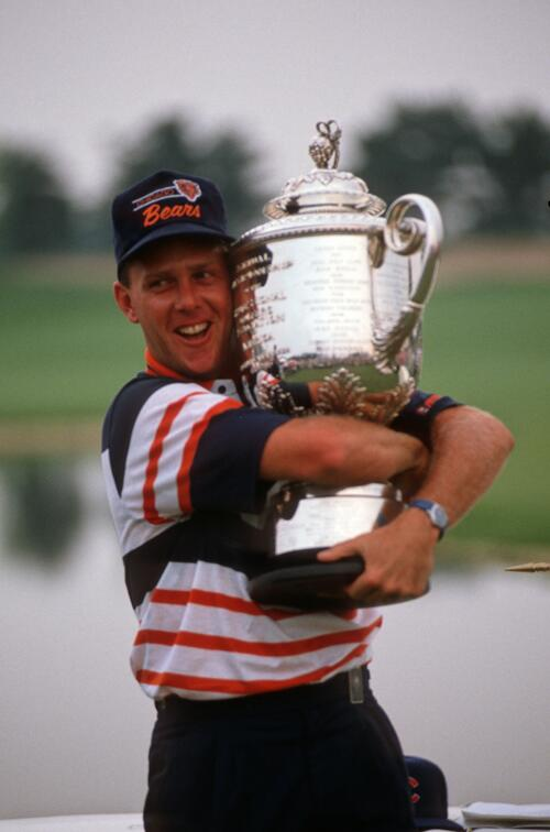 Winner Payne Stewart hugs the champion's trophy at the 1989 U. S. PGA Championship at Kemper Lakes