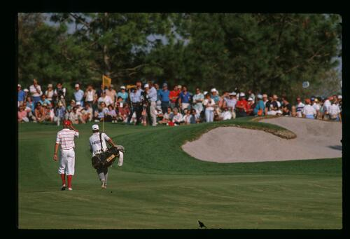 Golfer Payne Stewart and his caddie approach the green at the 1989 Nestle Invitational at Bay Hill