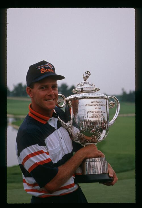 A victorious Payne Stewart lifts the Wanamaker Trophy at the PGA Championship at Kemper Lakes
