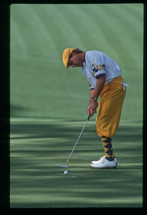Payne Stewart attempts his shortish putt on the 10th hole at the 1993 Masters Championship