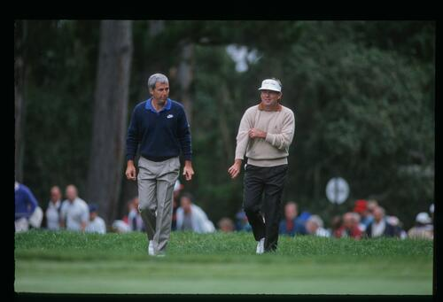 Friends and competitors Curtis Strange and Lanny Wadkins walk the fairway at the 1992 United States Open Championship at Pebble Beach