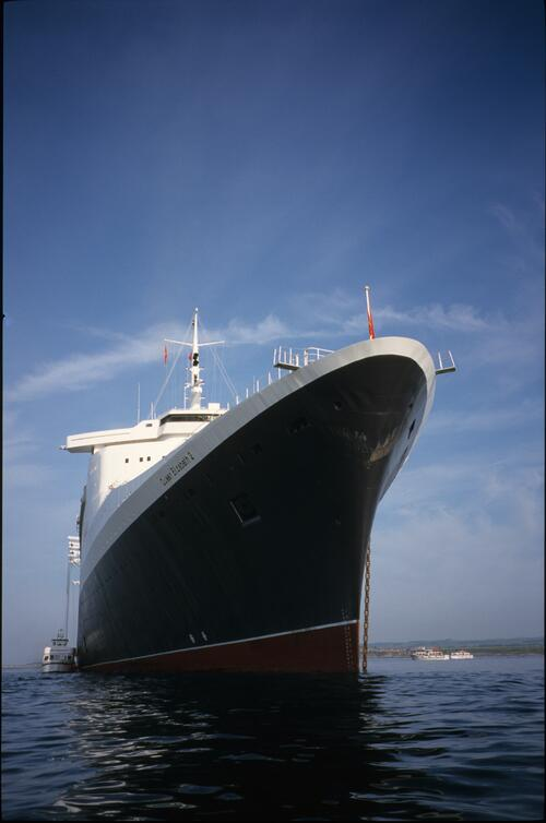 The QE2 (Queen Elizabeth II) as seen from under the bows.