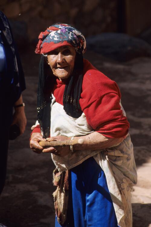 Old woman in red and blue, Irherm n'Ougdal.