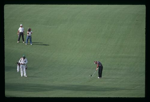 A scenic view of Lanny Wadkins playing his fairway approach shot at the 1991 Masters Championship
