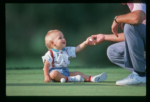 Golfer Lanny Wadkins spends some time with his son Travis at the 1988 World Series of Golf championship at Firestone