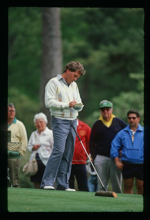 Golfer Lanny Wadkins checks his card on the tee at the 1988 Masters Championship