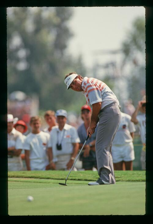 Lanny Wadkins follows his putt closely during the playoff with Larry Nelson at the 1987 U. S. PGA Championship