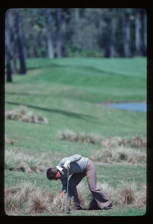 Golfer Lanny Wadkins finds his ball in trouble in the rough at the 1983 Players Championship at Sawgrass