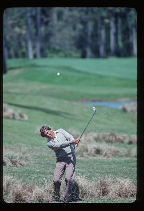 Lanny Wadkins plays his shot out of the long grass at the 1983 Players Championship at Sawgrass