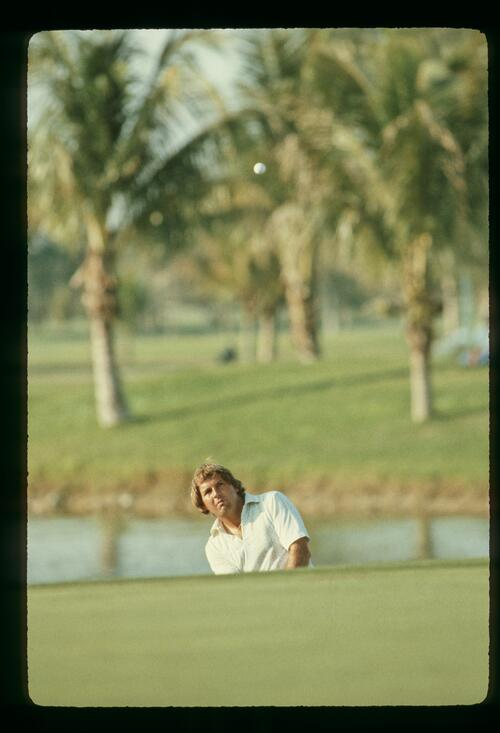Golfer Lanny Wadkins plays his pitch shot into the green at the 1981 Doral Eastern Open Championship