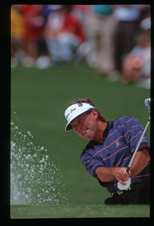 Golfer Lanny Wadkins splashes out of a greenside bunker at the 1992 Masters Championship