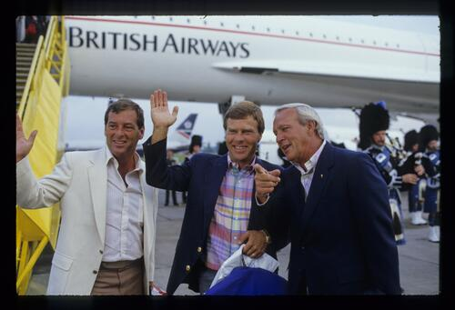 Lanny Wadkins, Ben Crenshaw and Arnold Palmer are given a piper's reception having traveled from the US on Concorde in readiness for the 1984 Open Championship