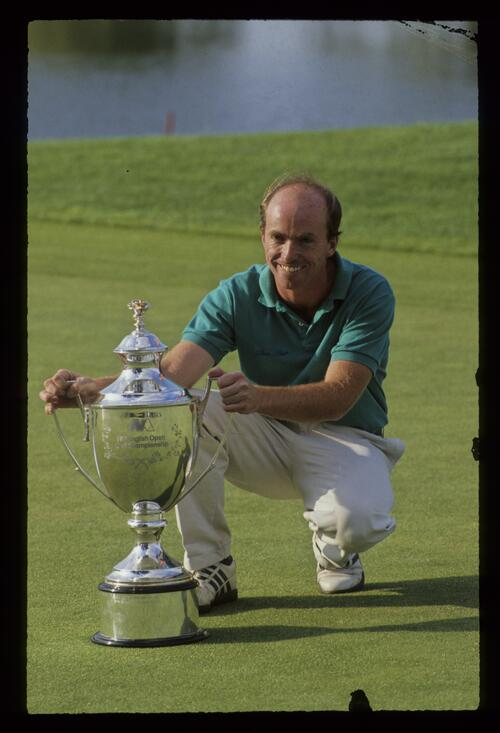 David Gilford poses on the 18th green with the 1991 English Open trophy