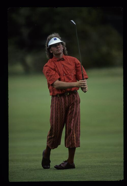 Australian golfer Stewart Ginn, in plus-fours, hits a long-iron from the fairway at the 1988 Australian Open