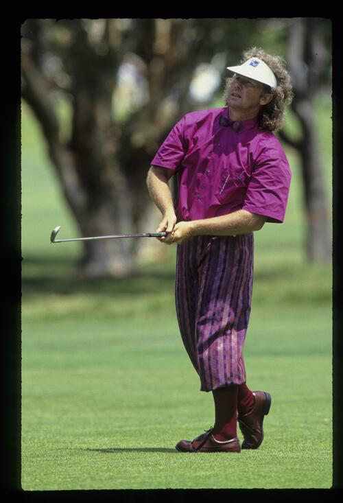Australian golfer Stewart Ginn, in plus-fours and bow-tie, hits a mid-iron from the fairway at the 1988 Australian Open