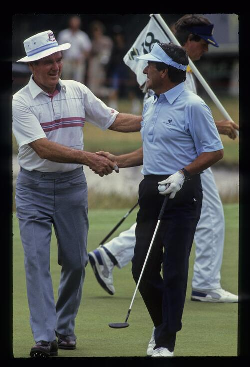 Australian golfers Kel Nagle and Peter Thomson shaking hands at the 1988 Bicentennial Classic