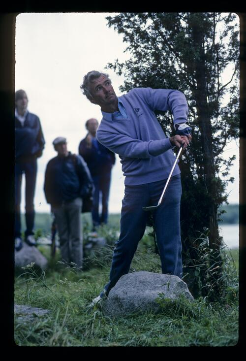 English golfer Brian Waites negotiating a rock in the rough at the 1983 Scandinavian Enterprise Open