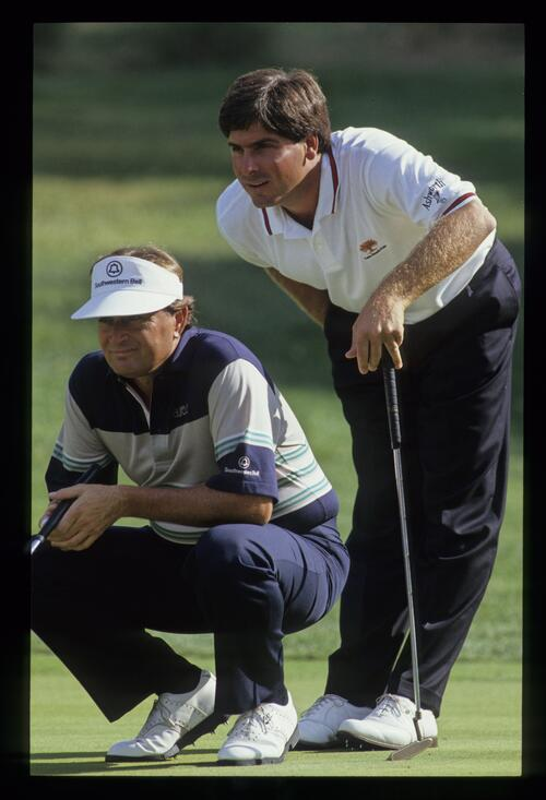 Raymond Floyd and Fred Couples considering a putt at the 1990 Ronald McDonald Children's Charity tournament