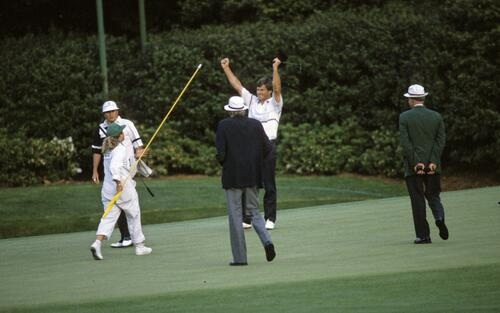 Nick Faldo sinks his par putt on the 11th - the second extra hole - to beat Raymond Floyd in the play off for the 1990 Masters, his second consecutive Masters win