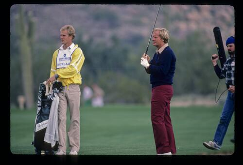 Jack Nicklaus and son Jackie watching his fairway shot closely during the 1984 Skins Game