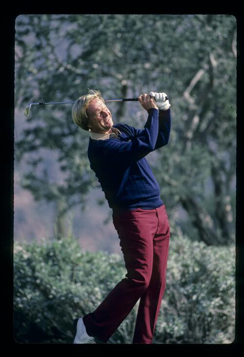 Jack Nicklaus squinting into the sun after hitting an iron shot during the 1984 Skins Game