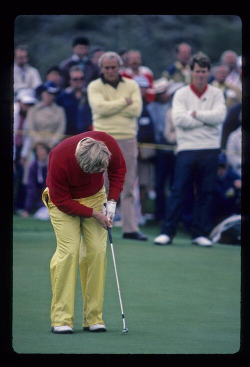 Jack Nicklaus crouching over a putt during the 1984 Skins Game