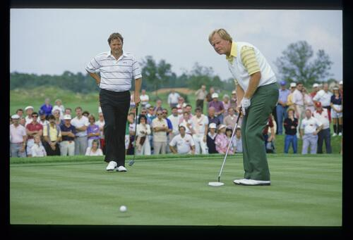 Raymond Floyd watching Jack Nicklaus putt during the 1986 Shark Shootout