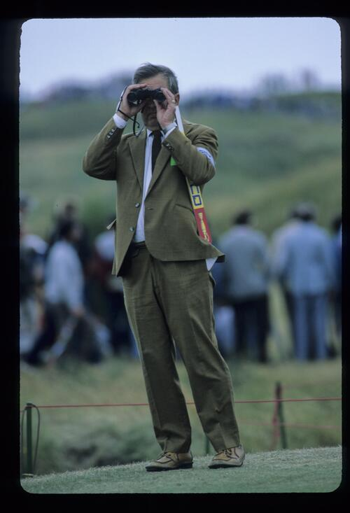 A steward using binoculars at the 1985 Open Championship