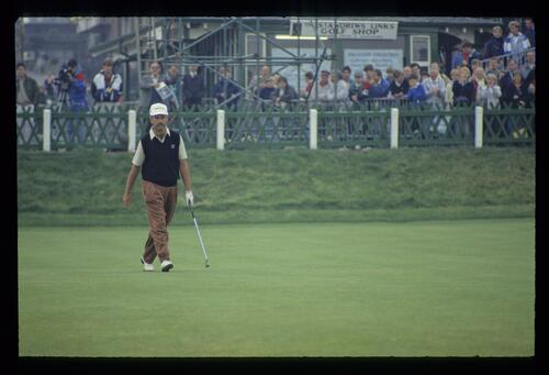 Mark James stalking across the 18th green at the 1990 Dunhill Cup