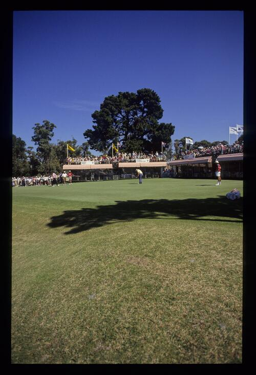 A golfer putting on the 18th green during the 1990 Australian Masters