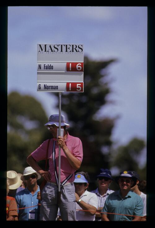 Scoreboard holder on the fairway during day four of the 1990 Australian Masters