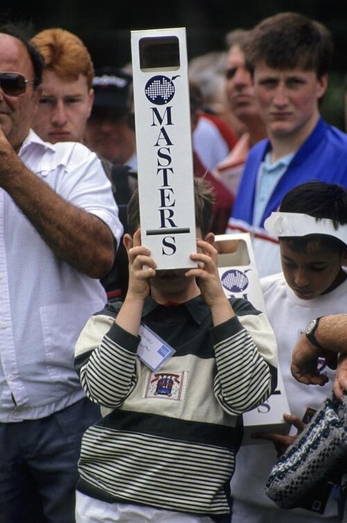A young spectator with periscope during the 1990 Australian Masters