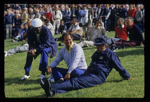 Calvin Peete, a smiling Mark O'Meara and a smoking Lee Trevino take time out at the 1985 Ryder Cup
