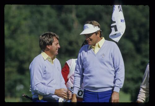 Lanny Wadkins and Raymond Floyd smiling on the 15th green at the 1985 Ryder Cup