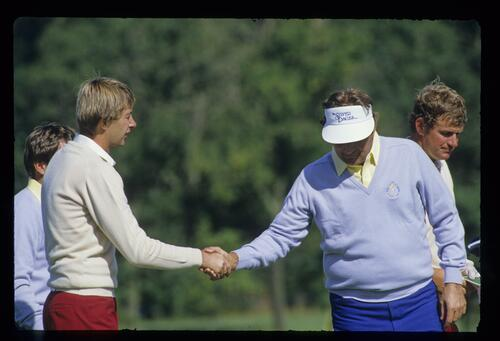 Ken Brown shakes hands with Raymond Floyd on the 15th green after he and Sandy Lyle had lost 4&3 to Floyd and Lanny Wadkins in the first day foursomes of the 1985 Ryder Cup