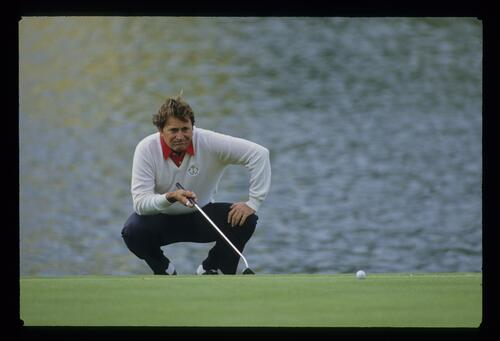 American golfer Raymond Floyd contemplates his putt at the 1985 Ryder Cup at The Belfry
