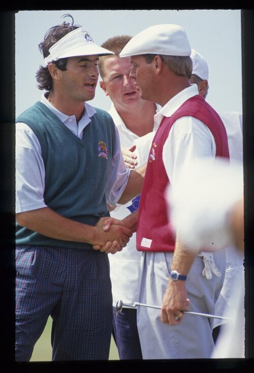 European golfer David Feherty shakes hands with rival Payne Stewart at the 1991 Ryder Cup