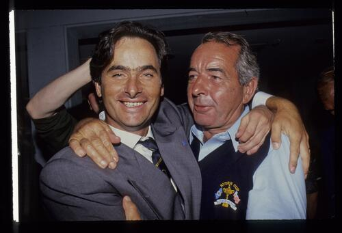 A smiling David Feherty hugs Bob Torrance at the 1991 Ryder Cup