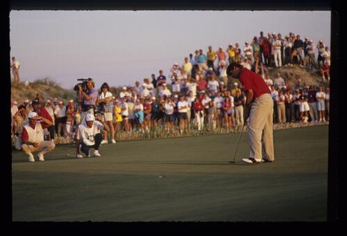 The very moment that the ball drops into the cup for Fred Couples as Payne Stewart and caddie look on appreciatively at the 1991 Ryder Cup